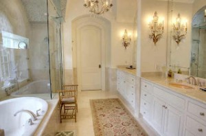 Inspired bathroom lighting how to brighten and highlight your coordinated crystal light fixtures can add antique sophistication to a bathroom with an otherwise relatively neutral aloadofball Choice Image