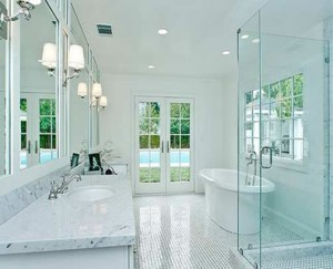 Inspired bathroom lighting how to brighten and highlight your though this bathroom gets lots of natural light the staggered recessed lights and repeating sconces ensure it will stay bright even after the sun sets aloadofball Choice Image