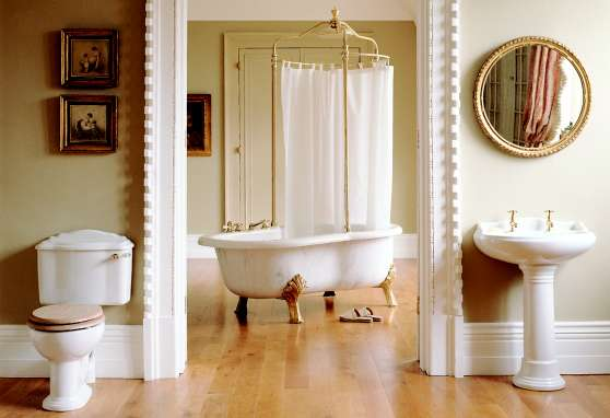 Edwardian Bathroom With Clawfoot Tub, Pedestal Sink, And Porcelain Toilet