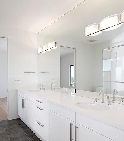 Double Bathroom Vanity With Full Wall Frameless Mirror By De Mattei Construction