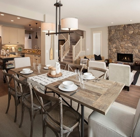 Combining Rustic Cross Back Dining Chairs With Crisp, Clean Upholstered Ones Creates a Style That's Both Casual And Classy (by Sabal Homes)