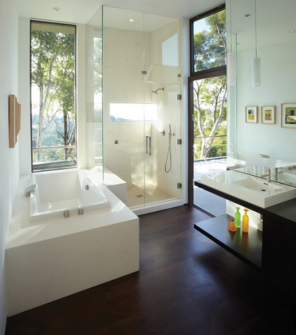 Attentive cleanup and good ventilation can keep hardwood bathroom floors looking beautiful (by Griffin Enright Architects)