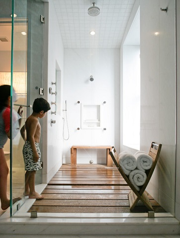 Teak wood shower floors are becoming an increasingly popular luxury option, and they come with the advantage of not only looking great, but also being much warmer and less slippery than more traditional tile