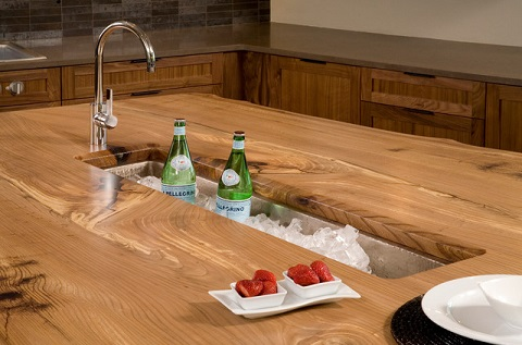 A Trough Style Sink In The Center Of The Kitchen Island Is Perfect For  Serving Drinks