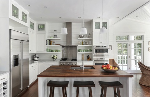 Most types of wood will work for a butcher block counter top, but be sure to choose one a few shades lighter than you'd like to end up with, as the wood will darken with age (by Diament Builders)