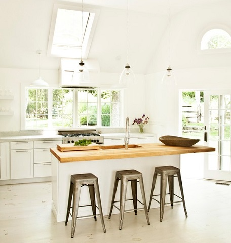 Wood countertops are perfect for adding a touch of natural warmth to a cool, contemporary white kitchen (by CLW interiors)