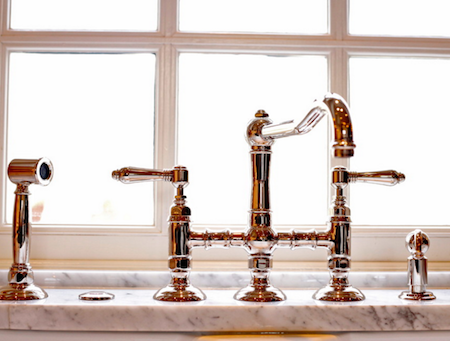 The bridge faucet is a popular style for vintage and farmhouse sinks. By Kitchen Kraft.