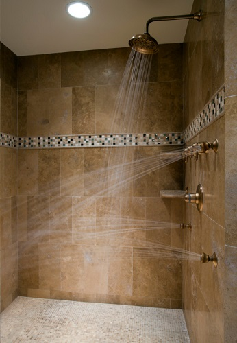 Running multiple shower heads at once can add up quickly - and can depelete your water heater faster than you might think (by On Time Baths)