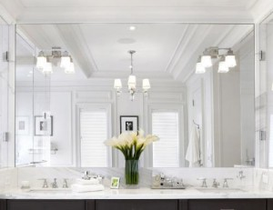 Matching Sconces And Chandeliers Keep This Bathroom Coordinated, And The Massive Mirror Doubles The Space, Making It Seem Even More Expansive
