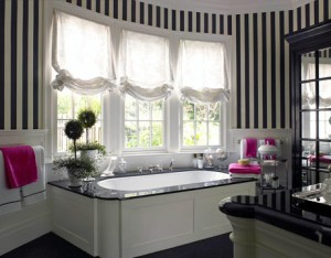 The White Vanity With A Black Marble Top Is Just The Beginning Of This Bold Bathroom