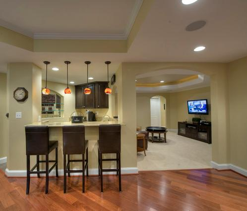 Back to basements seven basement remodels to update your for Basement apartment ideas plans