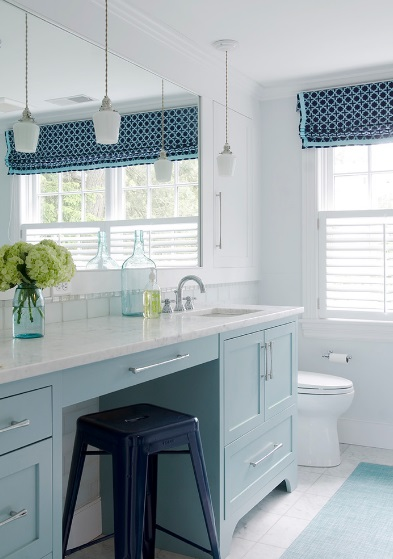 A vase can do wonders for bringing out the existing blue shades in a room. (by Kristina Crestin Design)