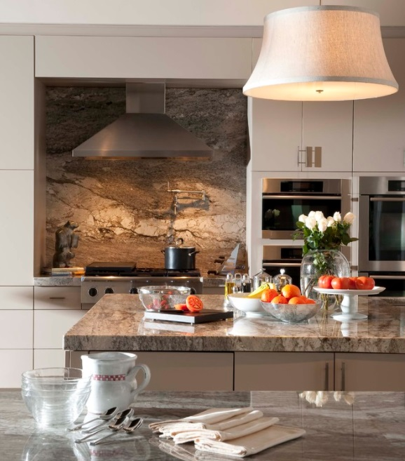 A single, seamless piece of decorative stone can be a bit pricy, but is a great showstopper for a mid-sized backsplash (by Wolfe Rizor Interiors)