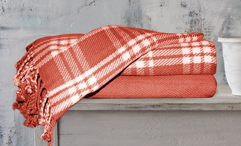 Thin cotton throws fold up small and are compact enough to tuck in a basket full of goodies