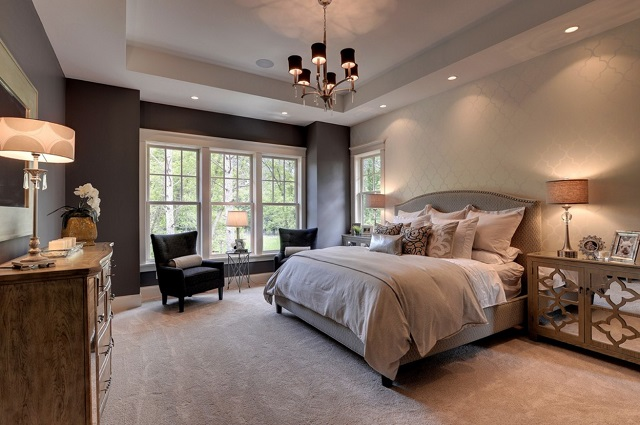 Recessed lighting gives you soft, diffuse, dimmable light above your bed, and can add a great layer of lighting throughout your bedroom (by Highmark Builders)