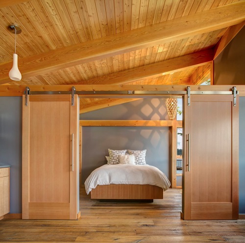 Barn doors are perfect for making your home feel more open while still allowing for privacy when it's desired (by FabCab)