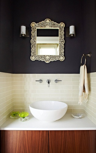 Solid black paint has a very modern feel, but tints that are just slightly off-black can have a surprisingly elegant feel in a more traditional space (by W. David Seidel, AIA)