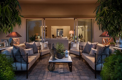 If you want to add a little indoor designer flair to your outdoor spaces, outdoor lamps are a great place to start (by Camelot Homes)