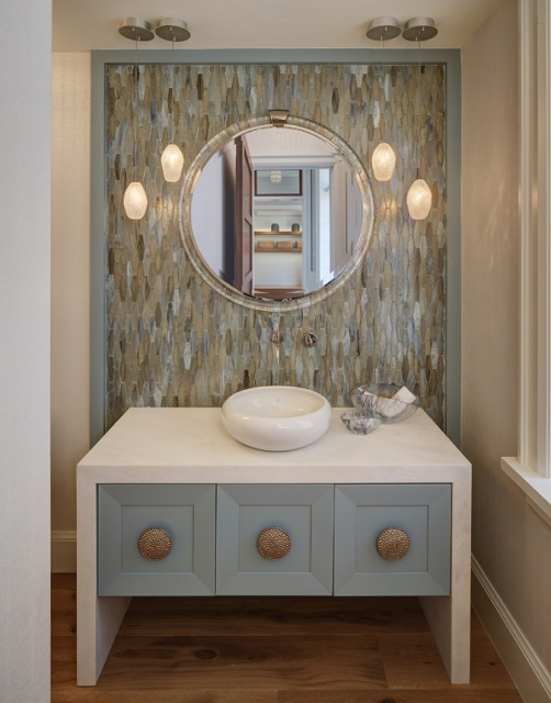 Upgrading from generic lighting fixtures to designer ones is a great way to give your bathroom a stylish, luxurious look and feel - even if the fixtures themselves aren't very expensive (by W Design Interiors)