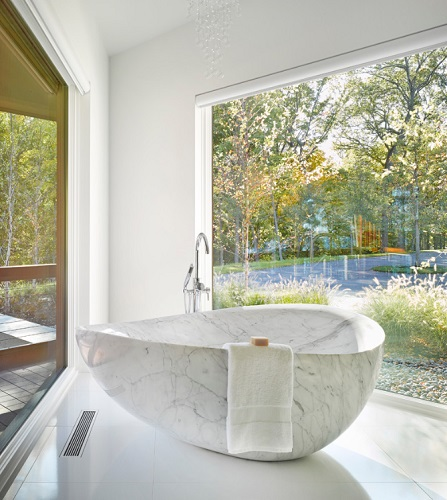 Stone bathtubs are absolutely stunning, but they do require a little TLC (by Birdseye Design)